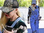Picture Shows: Gwen Stefani  January 21, 2016\n \n Singer Gwen Stefani is spotted out and about in Los Angeles, California. Gwen was looking trendy in a camouflage sweater, denim overalls, and orange Puma sneakers.\n \n Non Exclusive\n UK RIGHTS ONLY\n \n Pictures by : FameFlynet UK � 2016\n Tel : +44 (0)20 3551 5049\n Email : info@fameflynet.uk.com