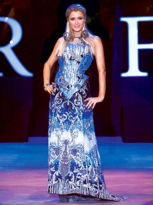 Paris Hilton poses in her gown by Falguni and Shane Peacock