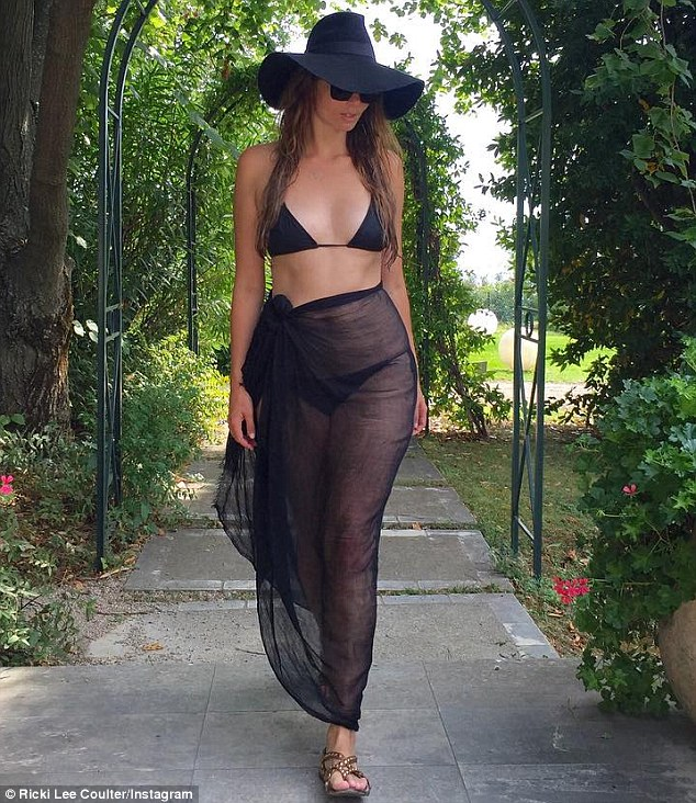 Life after marriage:Ricki-Lee Coulter turned heads on Friday as she stripped down to a tiny black bikini showing off her super toned figure while honeymooning in Europe