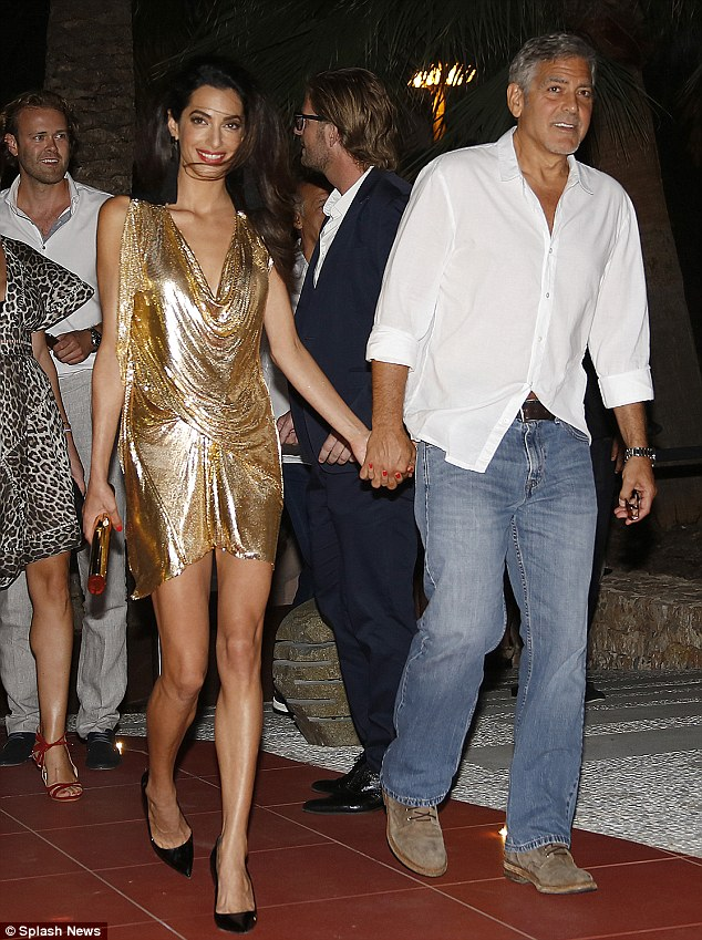 She's out of his league! George looked rather causal next to his sparkling wife