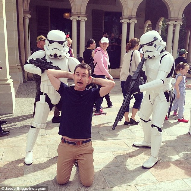 Two gun toting stormtroopers force a man to his knees at the Robotronica event in Queensland