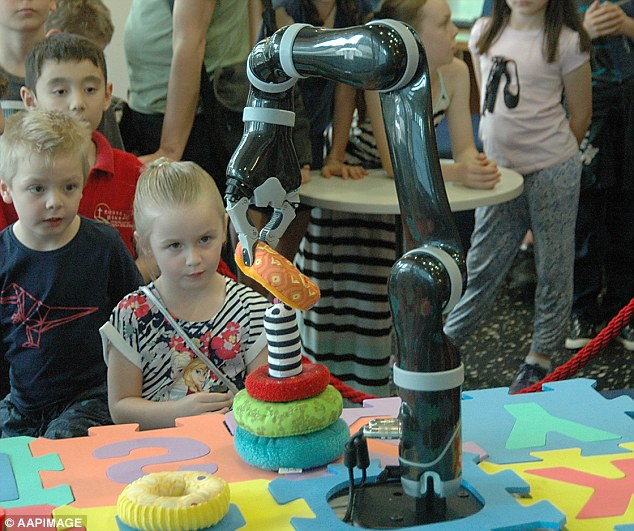 Thousands of children and adults flocked to the Queensland University of Technology on Sunday to take part in Robotronica