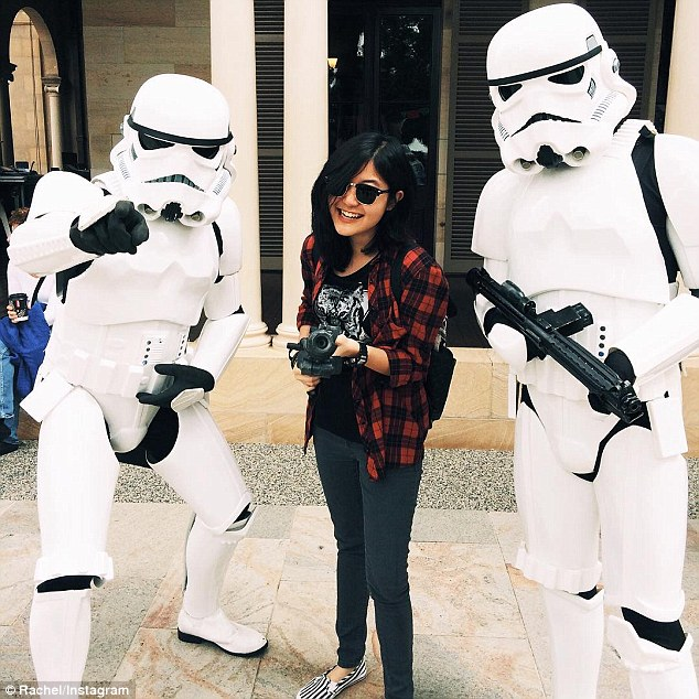 One woman satisfied her inner geek, holding a gun as she posed with two stormtroopers