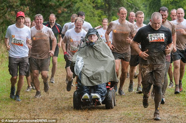 The 21-year-old took part in the gruelling 12-miles course in an off-road wheelchair set on top of a quad bike