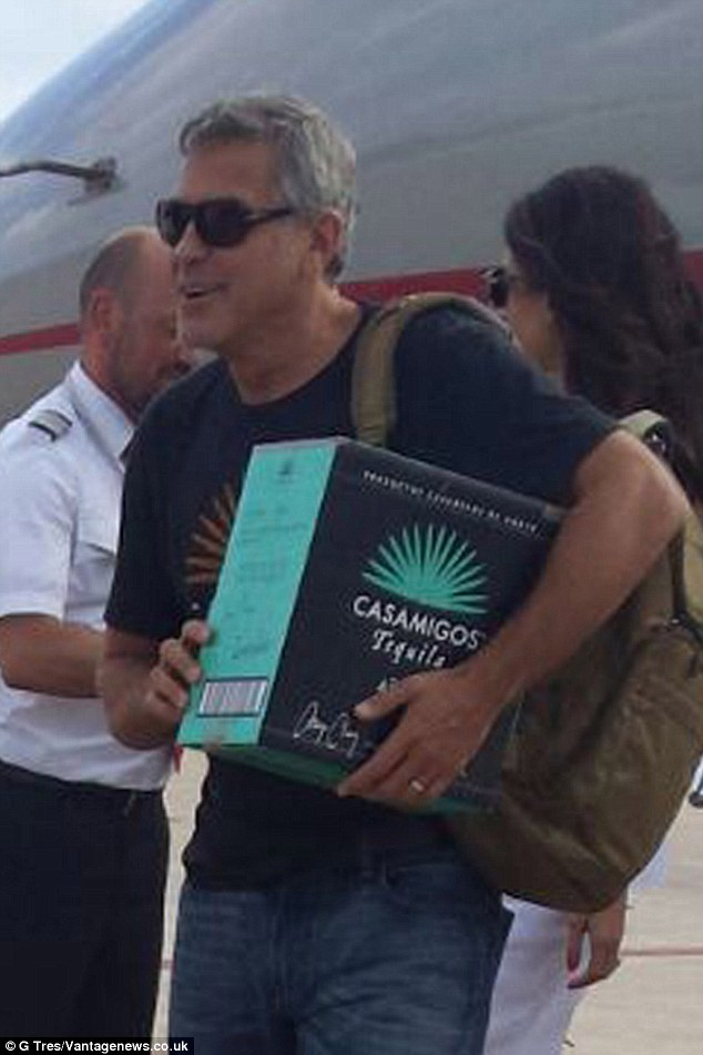 Product placement: The cunning actor was carrying a box as they left the jet after they arrived in Ibiza