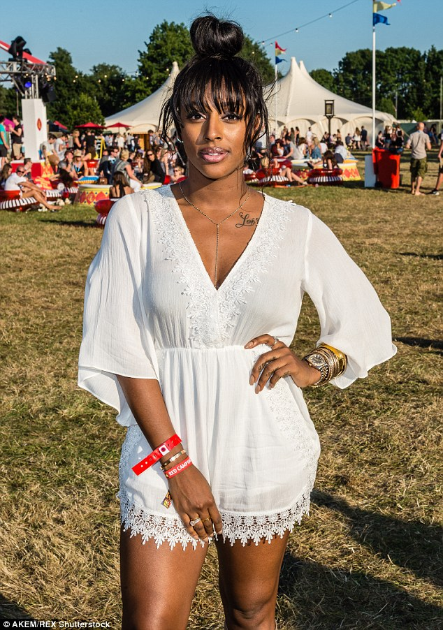 Plunging playsuit: The 26-year-old former X Factor star oozed a cool hippie glamour in the plunging garment, as she flashed a hint of her cleavage whilst enjoying the festival's Virgin Media VIP Louder Lounge