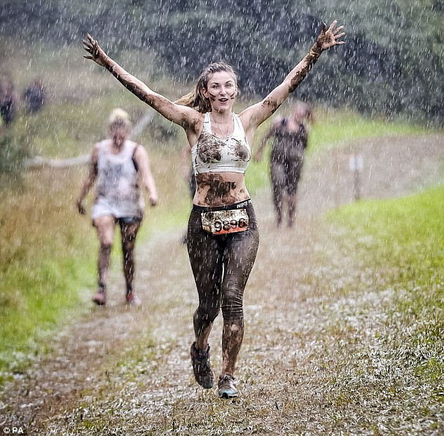 Despite the torrential rain and the gruelling race, this competitor manages to keep her spirits high while running
