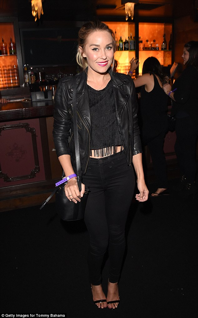 Black to basics: Lauren Conrad was also pictured at the event in a chic ensemble