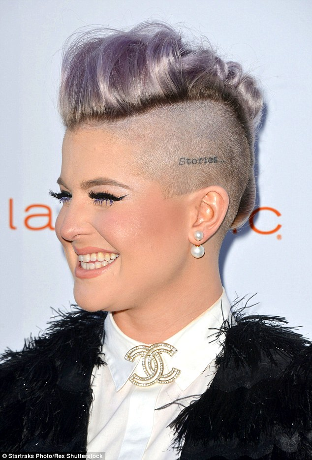 Turning heads: The former Fashion Police host fully showed off her freshly clipped purple undercut, which she styled into a high quiff - that showed off her head tattoo which reads 'stories'