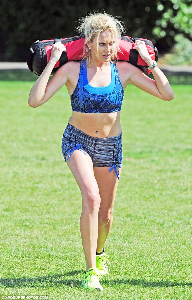 Heavy lifting: The Made In Chelsea star grimaced as she was put through her paces by her personal trainer