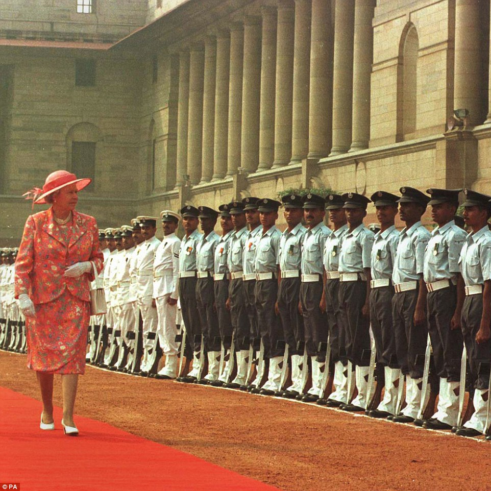Travelling: Queen Elizabeth II inspecting an Indian Forces' Honour guard at the Rashtrapati Bhawan (formerly the Viceroy's Palace and Secretariat) in the centre of New Delhi, India, on OCtober 13, 1997, in a visit that marked the 50th anniversary of the country's independence from Britain