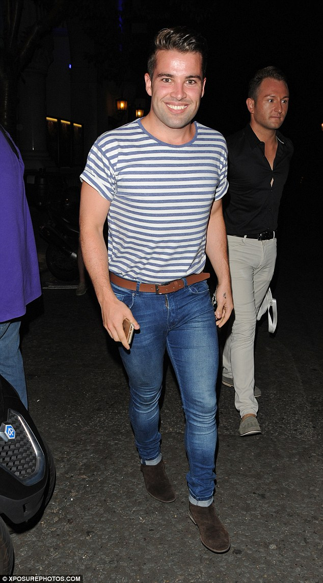 Buff body: The 24-year-old star made the most of his muscles in a striped T-shirt and skinny jeans