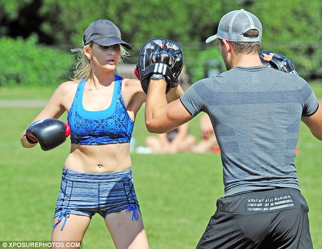 Serious face: The star was totally absorbed in throwing the best punch she possibly could