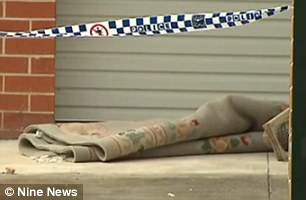 New South Wales Police at the crime scene removed a wheelbarrow (pictured) and a large roll of carpet from a granny flat in Epping