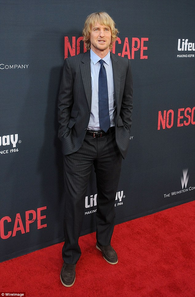 Solo run: The actor at Monday's premiere of his thriller, No Escape, in downtown LA. He plays a businessman who unwittingly takes his wife and two daughters to a country in the throes of a coup