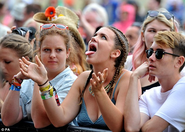 Wet wet wet: After the sunny weather of Saturday, festival-goers in Essex were forced to put up with the rain