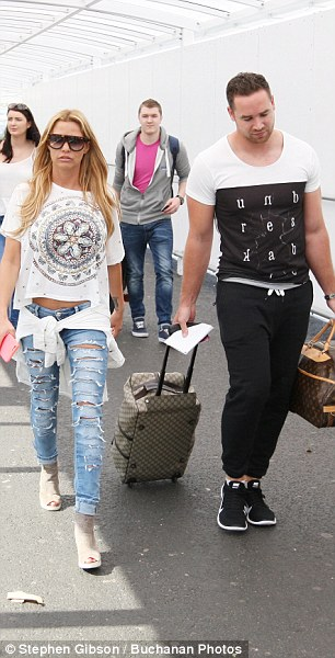 Fashionista: The mother-of-five showed off just a hint of skin in her crop top and ripped jeans