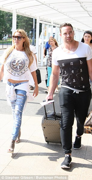Casual: She wore her blonde locks down loose and accessorised with tortoiseshell sunglasses