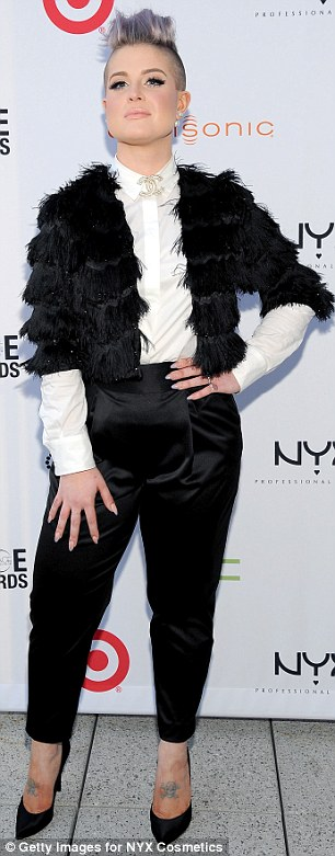 Monochrome marvel: Kelly opted for a black and white ensemble in a bang-on-trend demure white blouse