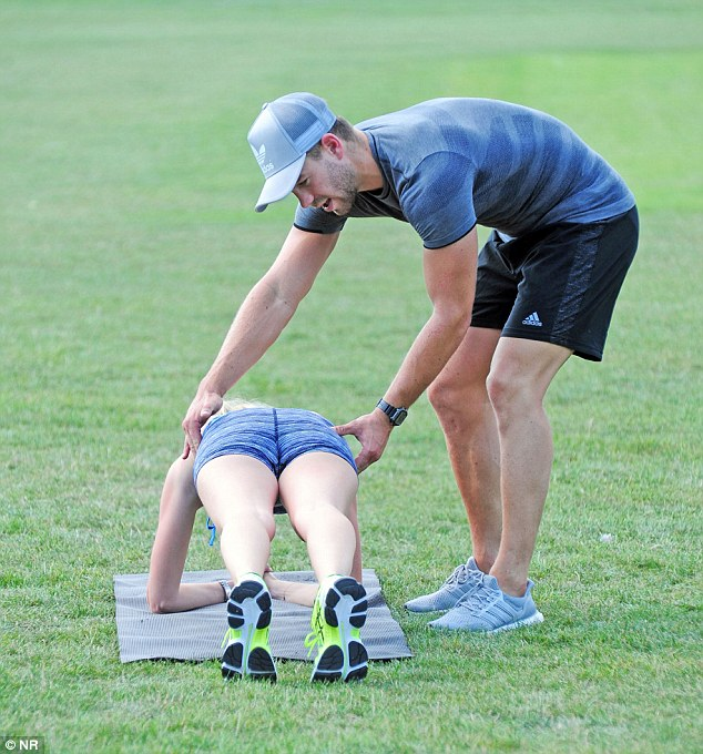 Helping hand: He ensured Stephanie's hips were level as she worked on defining her abs