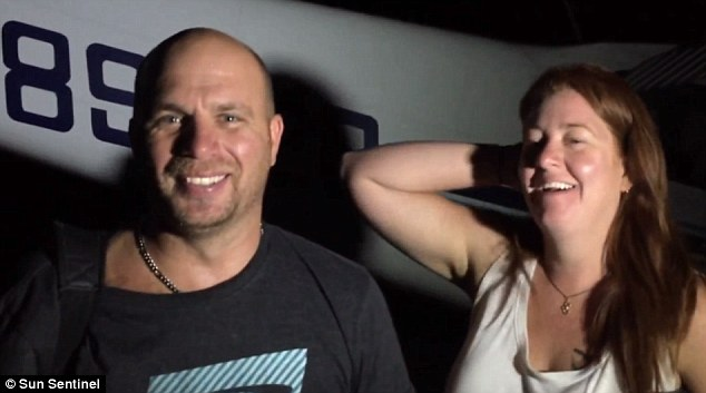 PilotJamie Barker (left) skillfully brought his plane down on the beach, telling a US broadcaster that he had 'done ok'. Pictured right is his passenger, Gina Mason