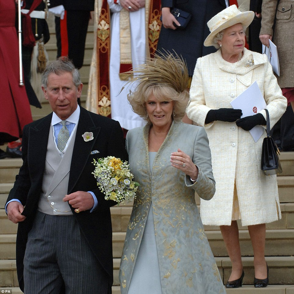 Wedding bells: The Queen is shown at the religious blessing of Prince of Wales and the Duchess of Cornwall's marriage at St Georges Chapel in Windsor on April 9, 2005. The monarch told guests in a speech at the wedding reception that her son was 'home and dry with the woman he loves'