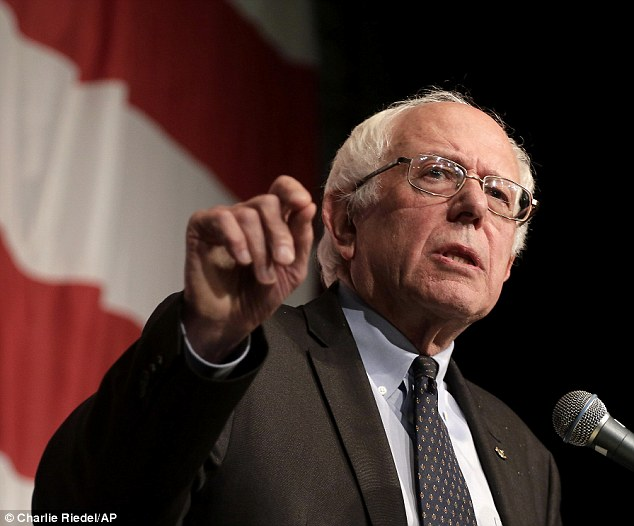Democratic presidential hopeful Bernie Sanders slammed billionaire businessmen the Koch brothers for being 'greedy' and destroying American democracy by piling money into campaigns. He is pictured at an event in Clear Lake, Iowa, last week