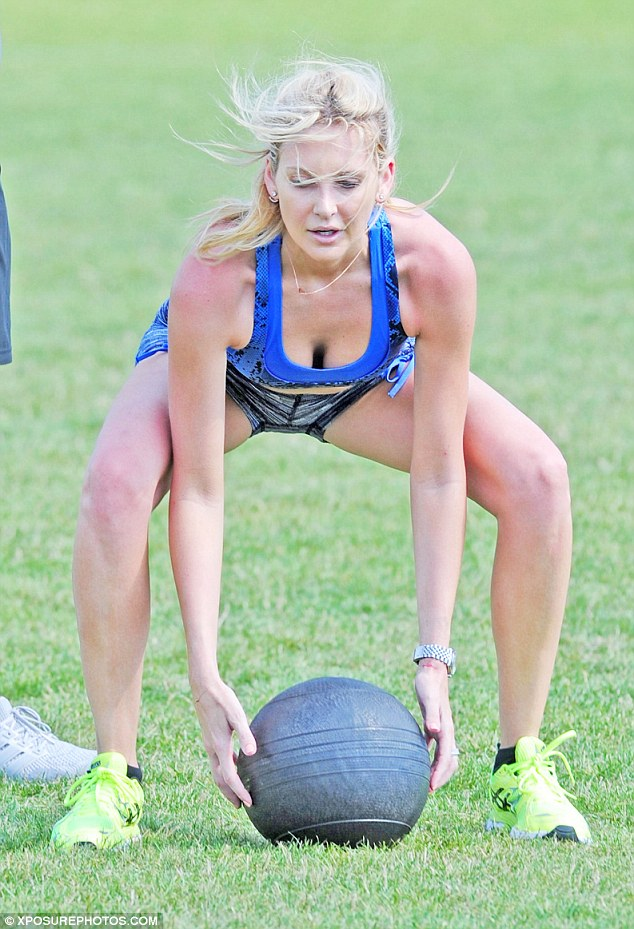 Working up a sweat: Stephanie Pratt was spotted excerising in a London park on Saturday in blue Lycra