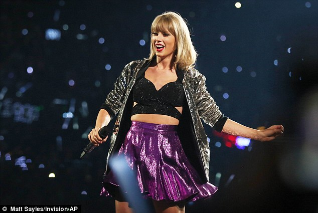 Shake it off: The singer looked flawless as always in her sparkling tour attire
