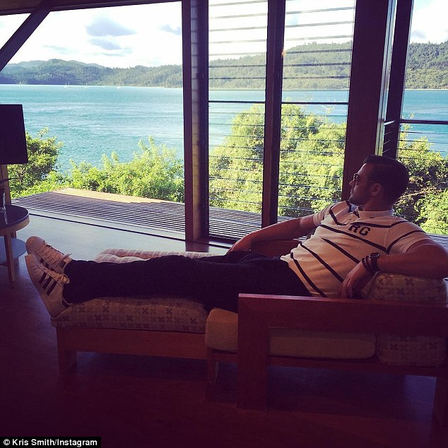 'My kinda place': Shortly after, the model then made his way to his exclusive five star accommodation at the island's Qualia Resort as he managed to put his feet up for a minute to recline in a plush sofa chair