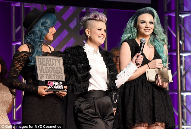 Bold style: She was joined on stage by the Beauty Vlogger award-winners Mykie