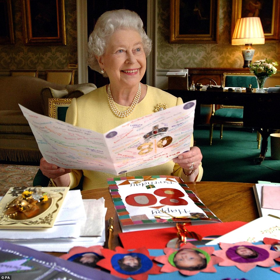 Birthday mail: Queen Elizabeth II sitting in the Regency Room at Buckingham Palace in London on April 20, 2006, looking at some of the cards which have been sent to her for her 80th birthday