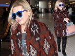 Actress Abigail Breslin was at LAX, boldly wearing a Native American designed sweater, and blue reflective sunglasses, over black tights and knee-high leather boots, with a patriotic t-shirt.  Friday, January 22, 2016  X17online.com\\nOK FOR WEB SITE AT 20PP\\nMAGAZINES NORMAL FEES\\nAny queries please call Lynne or Gary on office 0034 966 713 949 \\nGary mobile 0034 686 421 720 \\nLynne mobile 0034 611 100 011\\nAlasdair mobile  0034 630 576 519