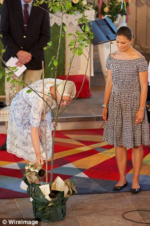 Princess Mette-Marit also waters the plant