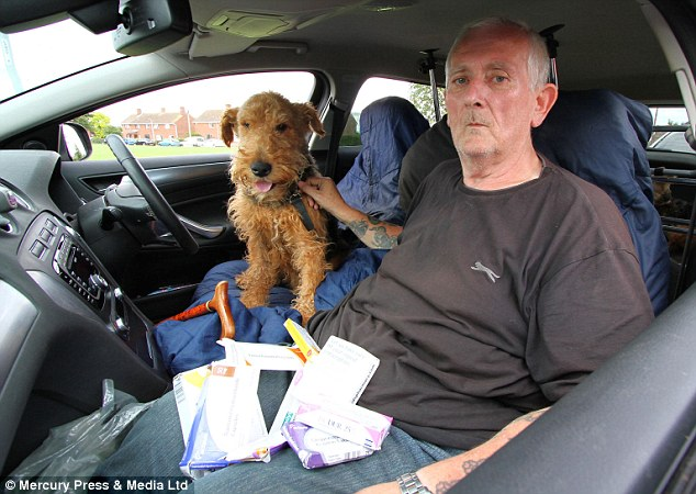 Desperate plight: Pensioner Ian Russell has been living in his car, parked in St Neots, Cambridgeshire, with his three Airedale terriers since March