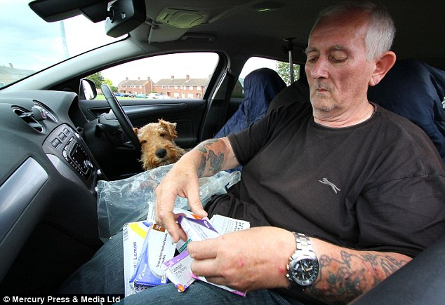 Stranded: Despite the fact his dogs cost him a quarter of his income, Mr Russell insists that he could never leave them behind