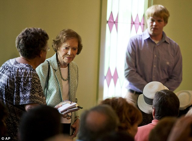Rosalynn Carter, center, wife of former President Jimmy Carter arrives to attend Sunday School class taught by her husband at Maranatha Baptist Church in his hometown The 90-year-old Carter gave one lesson to about 300 people filling the small Baptist church that he and his wife, Rosalynn, attend