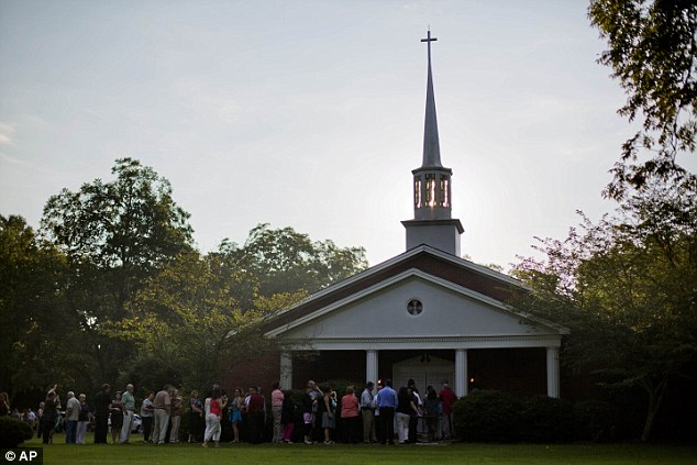 Long line: People line up as they wait to enter Maranatha Baptist Church for Sunday School class on Sunday