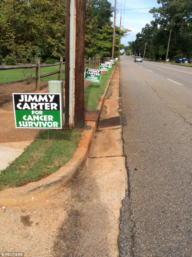 Following the signs: Lawn signs along a sidewalk is shown in this photo taken by former U.S. President Jimmy Carter in Plains, Georgia and tweeted by Jason Carter, his grandson on August 20, 2015