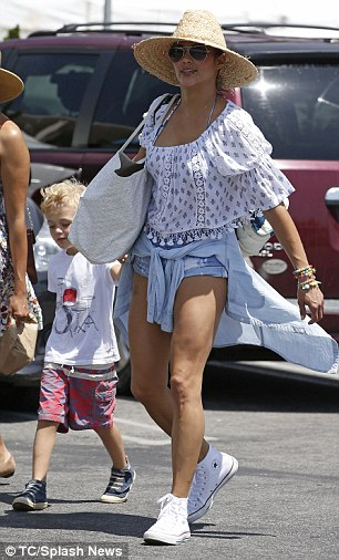 Legs for days! The 39-year-old Hitch star was wearing a bohemian-themed blouse with daisy duke denims