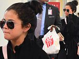 EXCLUSIVE: Selena Gomez was spotted arriving at Laguardia Airport in NYC on Monday evening, after being stuck in NYC after snowstorm Jonas. She was scheduled to leave after her SNL Performance, but had multiple flights cancelled because of the weather. She wore a long coat, Python Boots and carried her laptop , as she headed into the airport. She posed for photos with fans before boarding her plane to visit her family in Dallas\n\nPictured: Selena Gomez\nRef: SPL1214733  250116   EXCLUSIVE\nPicture by: 247PAPS.TV / Splash News\n\nSplash News and Pictures\nLos Angeles: 310-821-2666\nNew York: 212-619-2666\nLondon: 870-934-2666\nphotodesk@splashnews.com\n