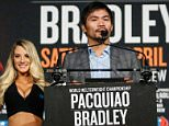 Boxers Manny PacquiaoC(C) and Timothy Bradley(R) attend a press conference at Madison Square Garden in New York on January 21, 2015, to announce their 12-round welterweight championship fight on April 9 in Las Vegas. / AFP / KENA BETANCURKENA BETANCUR/AFP/Getty Images