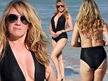PREMIUM RATES APPLY** EXCLUSIVE TO INF.  January 24, 2016: 'The  Real Housewives of New York' star Ramona Singer, who recently finalized her divorce, escaped Storm Jonas in New York by heading to Miami where she was seen showing off her curves in a low cut black one piece swimsuit on the beach.\nMandatory Credit: INFphoto.com Ref: infusmi-11/13