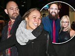 EXCLUSIVE: Ronda Rousey and boyfriend Travis Browne climb over a snow bank after the Saturday Night Live afterparty in NYC\n\nPictured: Ronda Rousey, Travis Browne\nRef: SPL1214195  240116   EXCLUSIVE\nPicture by: XactpiX/Splash News\n\nSplash News and Pictures\nLos Angeles: 310-821-2666\nNew York: 212-619-2666\nLondon: 870-934-2666\nphotodesk@splashnews.com\n