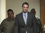 Curtis Lovelace, second from left, is escorted to a courtroom for the start of his murder trial by sheriff's deputies Monday, Jan. 25, 2015, at the Adams County Courthouse in Quincy, Ill. Lovelace, a former University of Illinois football star and Adams County prosecutor, is accused of suffocating his wife, Cory, on Feb. 14, 2006. (Phil Carlson/The Quincy Herald-Whig via AP)