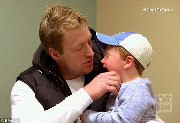 Broken leg: Her husband Kroy tried to comfort his son KJ who broke his leg while playing rough with nanny Lana