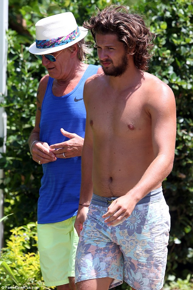 Like father, like son! The professional ice hockey player looked handsome in a pair of floral swimshorts