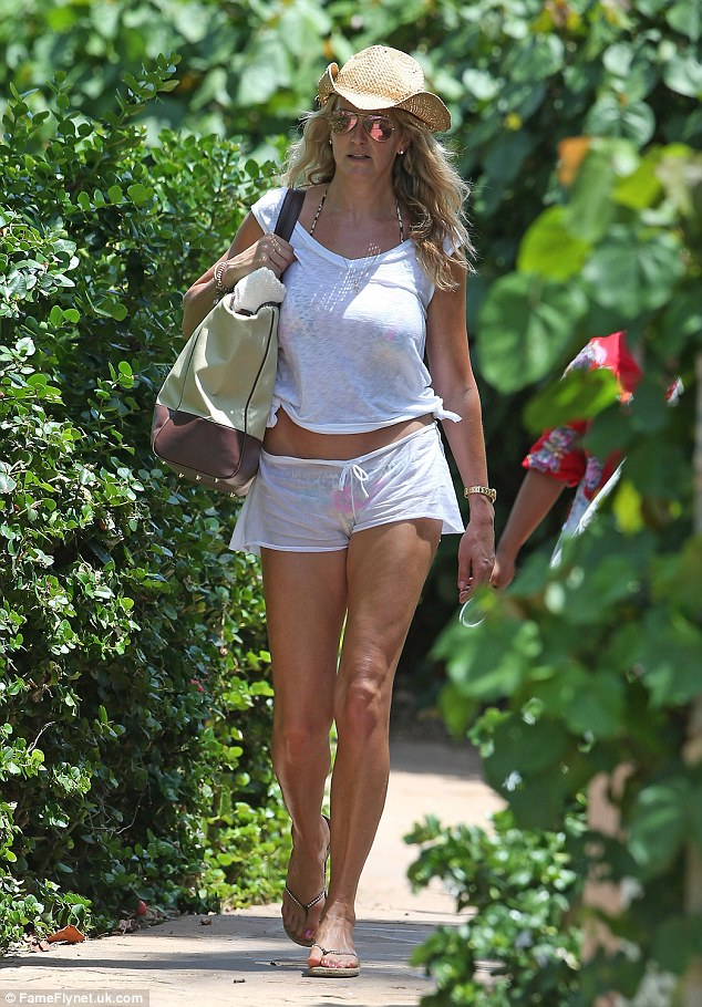 Wonderful in white: Penny headed down to the beach in a white T-shirt and tiny shorts combo