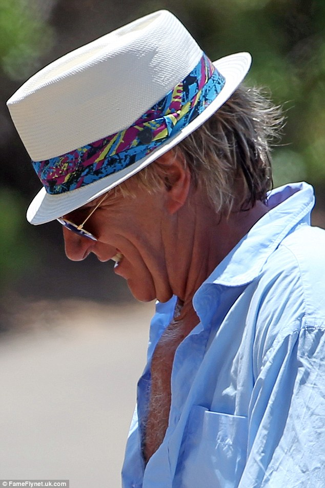 Quirky style! Rod rocked a white straw hat, which was lined with a multi-coloured piece of fabric
