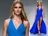 British model Rosie Huntington-Whiteley wears a creation as part of Versace's spring- summer 2016 Haute Couture fashion collection presented in Paris, Sunday, Jan. 24, 2016. (AP Photo/Thibault Camus)
